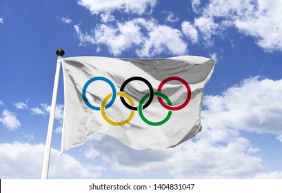 Tokyo, Japan - June 01, 2019: Olympic flag, the official symbol of the olympics, floating under a blue sky, shows the five Olympic rings, rings the continents of the world.