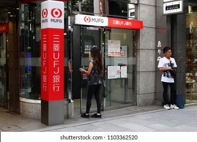 TOKYO, JAPAN - June 1, 2018: A customer entering a Ginza branch of the bank Tokyo-Mitsubishi UFJ in Tokyo.