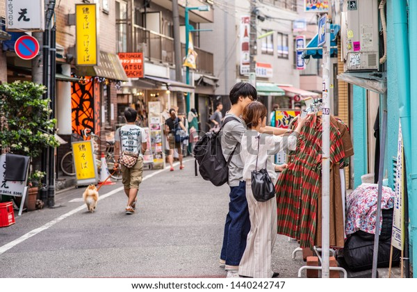 Tokyo, Japan - June 1, 2019: A stylish couple goes vintage shopping in Shimokitazawa, a cool Setagaya neighborhood known for great shopping and nightlife. More than 800,000 live in Setagaya.