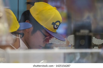 TOKYO, JAPAN - JUNE 12TH, 2019. Close up view of a Japanese fast food eatery staff in Yurakucho district.