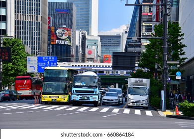 TOKYO, JAPAN - June 13, 2017 : Hibiya intersection. This intersection is long streets lined with tall buildings span the distance between Hibiya and the coastline at Hama-Rikyu and its vicinity.