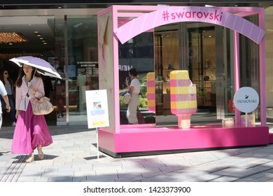 TOKYO, JAPAN - June 13, 2019: Temporary Swarovski crystal summery display in front of the Omotesando Hills shopping center. It has been set up to promote a Swarovski pop-up store inside the complex.