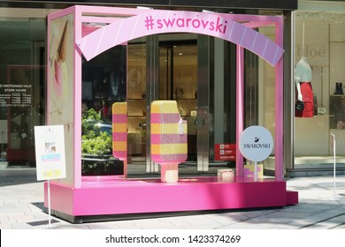 TOKYO, JAPAN - June 13, 2019: Temporary Sworovski crystal summery display in front of the Omotesando Hills shopping center. It has been set up to promote a Sworovski pop-up store inside the complex.