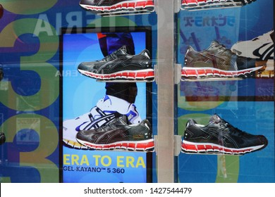 TOKYO, JAPAN - June 13, 2019: Asics sneakers displayed in an Asics Tiger store in Tokyo's Harajuku area.