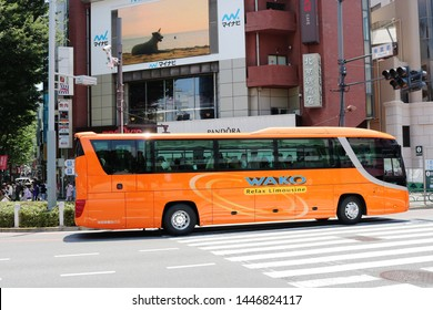 TOKYO, JAPAN - June 13, 2019: A tour bus in Tokyo's Harajuku / Omotesando district.