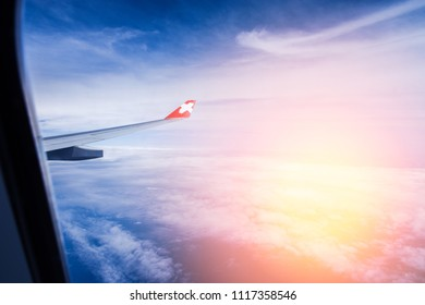 Tokyo, Japan - June 14, 2018 - Wing Airplane Flying Above The Clouds On Twilight Sky Background. Nice View Of Cumulus Clouds With Sunrise From Airplain Window. Image For Templates, Placards, Banners.