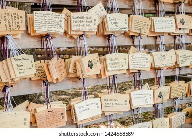 TOKYO, JAPAN - June 15, 2019: Ema (Wooden prayer tablets) at Meiji Shrine. Ema are small wooden plaques used for writing prayers or wishes by shinto believers.