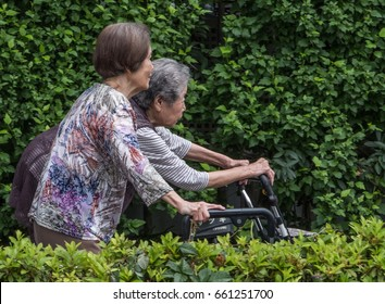 TOKYO, JAPAN - JUNE 15TH 2017. Elderly Japanese women walking in a park. Japan aging population is purported to have the highest proportion of elderly citizens compared to other countries.