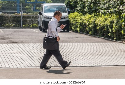 TOKYO, JAPAN - JUNE 15TH 2017. Japanese white-collar worker or salaryman. Salaryman refers to a man whose income is salary based, particularly those working for corporations for long hours.