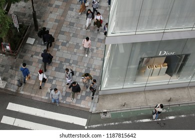 TOKYO, JAPAN - June 16, 2018: Overhead  view of a street in Omotesando with the Sanaa-designed Christian Dior store on the right.
