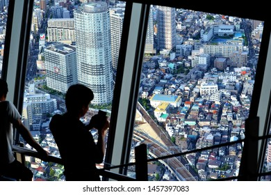 Tokyo, Japan - June 16th 2019 : Person who look the view and take a picture from the Tokyo Skytree