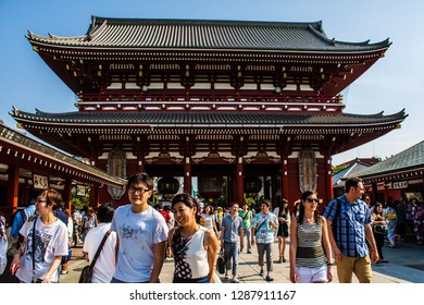 TOKYO, JAPAN - JUNE 18, 2016 : Senso-Ji, the oldest temple in Tokyo. Tourists walking around the most famous Sensoji buddhist temple at Asakusa area in Tokyo,Japan. Visit to Asakusa Kannon Temple