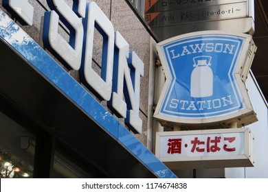 TOKYO, JAPAN - June 19, 2018: The sign attached to a Lawson convenience store in Tokyo's  Shibuya area.