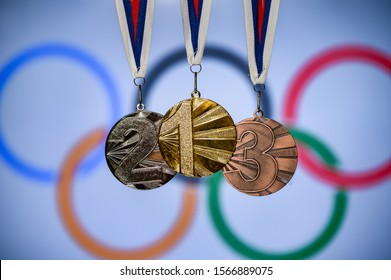 TOKYO, JAPAN, JUNE. 20. 2019: Silhouette of medal trophy, olympic circles in background. Background photo for olympic game 2020 in Tokyo, Japan