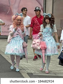 Tokyo, Japan - June 2010: Two gothic lolitas walk in the street in Harajuku district in June 2010 in Tokyo. Harajuku district is a traditional meeting place of young people in Tokyo.