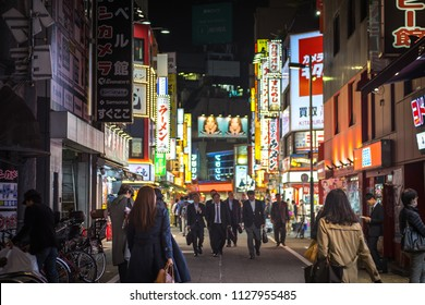 Tokyo / Japan - June 2018 : Tokyo night life at shopping area near Shinjuku - Shibuya. Too many office employees and people going to hang out after done hard work. (Wide focus at background).