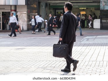 TOKYO, JAPAN - JUNE 20TH 2017. Japanese white-collar worker or salaryman. Salaryman refers to a man whose income is salary based, particularly those working for corporations for long hours.