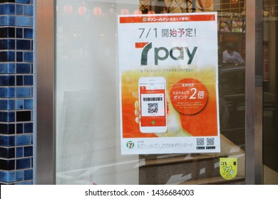 TOKYO, JAPAN - June 21, 2019: A poster in the window of of 7-Eleven convenience store advertising 7pay a new 7-eleven payment app.