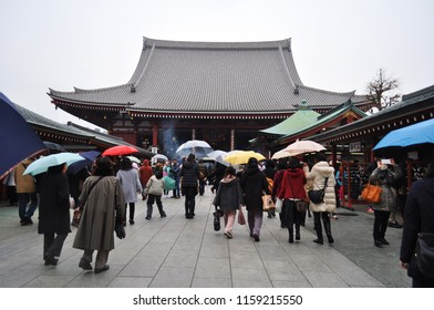 Tokyo, Japan- June 23, 2015:  Crowded people walking in and walking out with their several umbrellas in rainy day, Senso-ji, Asakusa, a temple in Toyko.
