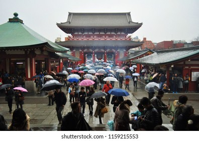 Tokyo, Japan- June 23, 2015:  Crowded people walking in and walking out beautifully with their several umbrellas in rainy day, Senso-ji, Asakusa, a famous temple in Toyko.