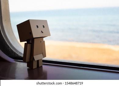 TOKYO, JAPAN - JUNE 24, 2017: Danboard anime figure standing by the window with beach scenery