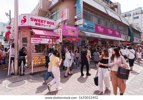 TOKYO, JAPAN - June 24, 2017 : Tourists and locals crowd in Takeshita Street (Takeshita Dori) in Harajuku. Takeshita Dori is considered a birthplace of Japan's fashion trends