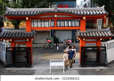 TOKYO, JAPAN - June 24, 2018: View from the top of the steps of Bishamonten Zenkokuji Temple which is located next to a busy hilly street in Tokyo's Kagurazaka area.