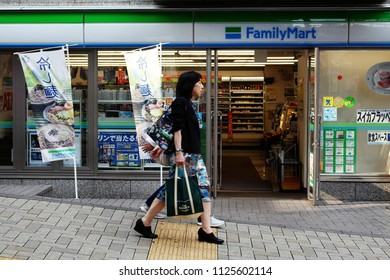 TOKYO, JAPAN - June 24, 2018: View of the front of a FamilyMart convenience store on a hill in the Kagurazaka area of Tokyo.