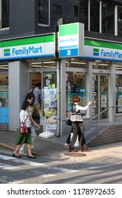 TOKYO, JAPAN - June 24, 2018: View of the sidewalk in front of a FamilyMart convenience store on the corner of a street in the Kagurazaka area of Tokyo.