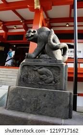 TOKYO, JAPAN - June 24, 2018: Tiger statue at Kagurazaka's Bishamonten Zenkokuji Temple. The statue replaces the common komainu (lion-dog) variety. Dutch angle shot with some perspective distortion.