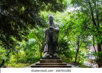 TOKYO, JAPAN - June 25, 2017: Bronze statue of Confucius, Chinese politician and philosopher, at Yushima Seido, a Confucian temple in the Yushima neighbourhood of Bunkyo