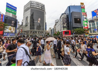 Tokyo, Japan - June 26, 2010: Wideangle photo of the crowds of people at Shibuya Crossing on a cloudy day on 26 June 2010. Shibuya is probably the best known meeting place in Tokyo.