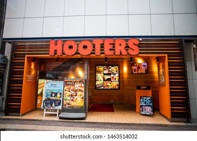 Tokyo, Japan - June 26, 2019: Hooters exterior and logo. Hooters is a casual dining restaurant chain in a lot of countries, founded in the United States