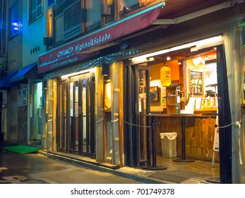 TOKYO, JAPAN JUNE 28 - 2017: Traditional back street bars in Shinjuku Golden Gai. Golden gai consists of 6 tiny alleys with 200 tiny bars and 20th century atmosphere, located in Tokyo