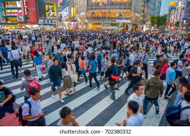 TOKYO, JAPAN JUNE 28 - 2017: Unidentified people crossing the Shibuya street in Tokyo, Japan. The famous scramble crosswalk is used by over 2.5 million people daily