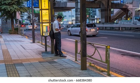 TOKYO, JAPAN - JUNE 28TH 2017. View of a street sidewalk in Ikejiri Ohashi neighbourhood. The neighbourhood is within a short walking distance from the more popular Shibuya District.