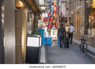 TOKYO, JAPAN - JUNE 30TH 2017. Office worker in  Shimbashi district. Packed with tiny eateries and bars, the district is where office workers come to eat and entertain themselves.