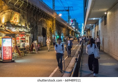 TOKYO, JAPAN - JUNE 30TH 2017. Restaurants and local bars (izakaya) along the Japan Railway track. Known as Gado Shita, it attracts office workers for its cheap and delicious food and drinks,
