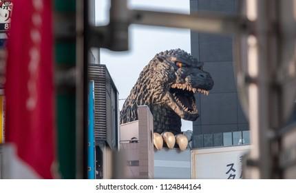 TOKYO, JAPAN - JUNE 30TH, 2018. Godzilla, popular Japanese pop cilture monster, overlooking a street in Kabukicho district, Shinjuku.