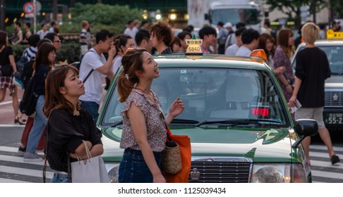 TOKYO, JAPAN - JUNE 30TH, 2018. Tourists and locals crossing the street of Kabukicho, Shinjuku.