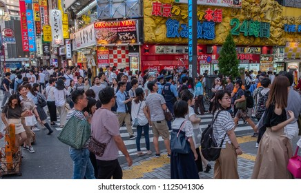 TOKYO, JAPAN - JUNE 30TH, 2018. Crowd of people walking at Godzilla Road sign in Kabukicho district, Shinjuku.