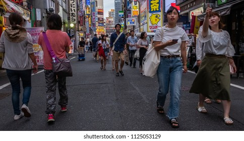TOKYO, JAPAN - JUNE 30TH, 2018. Crowd of people walking in the street of Kabukicho, Shinjuku.