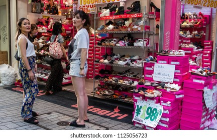 TOKYO, JAPAN - JUNE 30TH, 2018. Crowd of people walking in at the pedestrian street in Shinjuku.