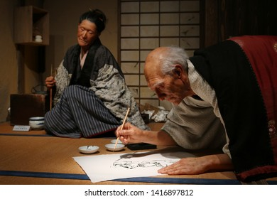 TOKYO, JAPAN - June 5, 2019: View of an animatronic exhibit featuring animatronic figures of the painters Hokusai and his daughter Oei at the Sumida Hokusai Museum.