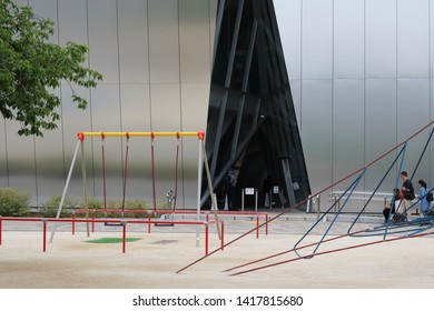 TOKYO, JAPAN - June 5, 2019: View of the entrance to the Kazuyo Sejima-designed Sumida Hokusai Museum which is located in a park.