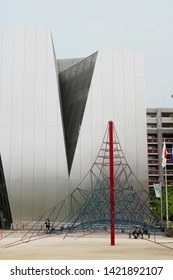 TOKYO, JAPAN - June 5, 2019: The front of the Kazuyo Sejima-designed Sumida Hokusai Museum which is located in a park.