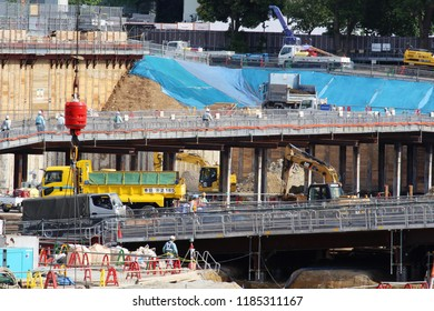 TOKYO, JAPAN - June 9, 2017: Workers and machinery on construction site for the Kengo Kuma-designed National Stadium being built for the 2020 Tokyo Olympics when work was at quite an early stage.