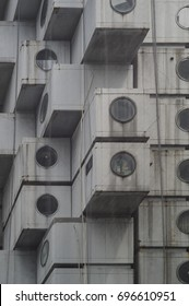 Tokyo, Japan - June 9 2017: Nakagin Capsule Tower is a mixed-use residential and office tower designed by architect Kisho Kurokawa and located in Shimbashi, Tokyo, Japan