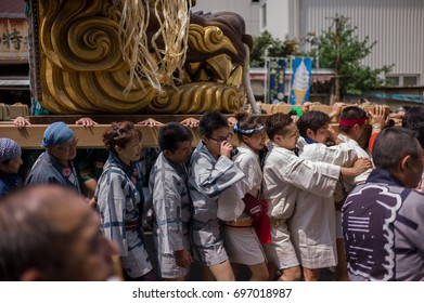 Tokyo, Japan - June 9 2017: A group of people celebrate the festival of Tsukiji Fish Market in Tokyo.