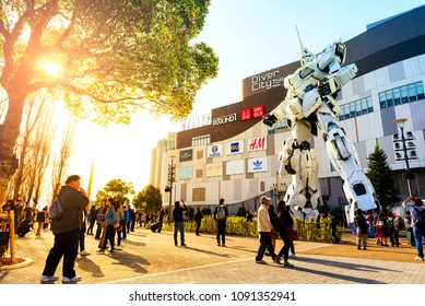 TOKYO JAPAN - MAR.31,2018 : Odaiba neighborhood, Popular tourists walk & take pictures of large robots. This robot is in a movie in the past named Gundam. One of Tokyo's must-see places to visit.